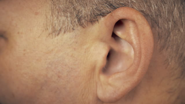 Man left ear. Macro extreme close up view of male ear. Concept for audio music sound health human ear. video