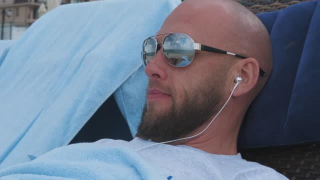 Man lies in headphones.