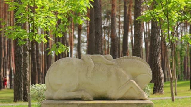 Man Lies on Horse Sculpture video