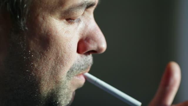 Man Lighting Cigarette video