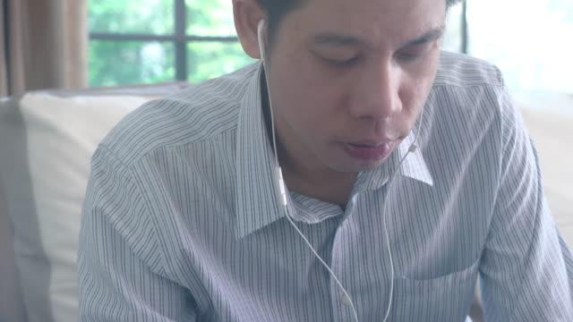 700034768 Man listening radio via headphones video