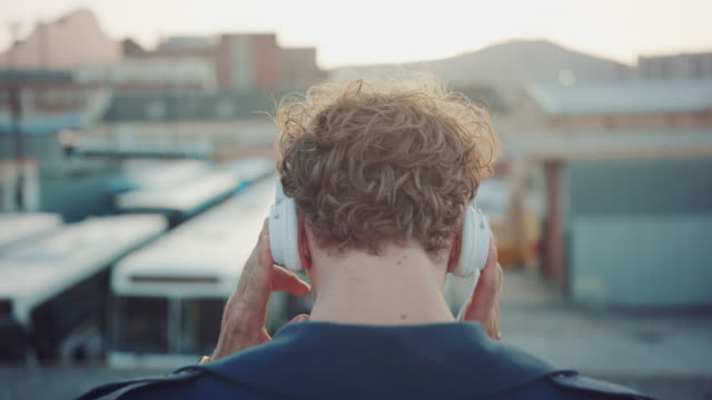 Man listening to music on rooftop video