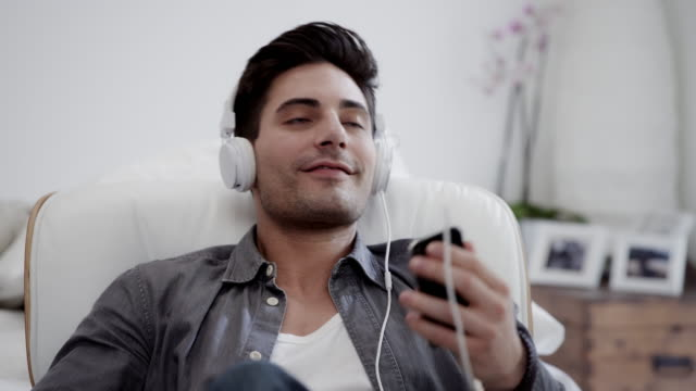 Man listening to music video