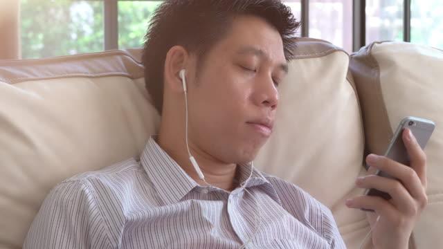 Man listening via headphones video