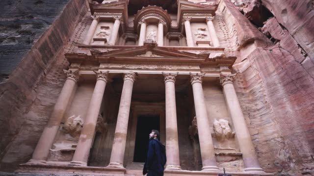Man looking at Al-Khazneh in Petra Young Caucasian man  looking at Al-Khazneh in Petra treasury stock videos & royalty-free footage