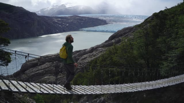 Man looking at Grey glacier in Torres del Paine National Park