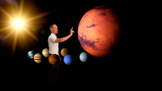 Man looking at the planets video