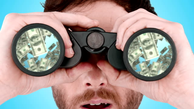 Man looking through binoculars video