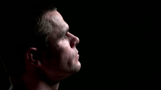 Man looking up, at camera, then smirking video
