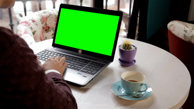 Man looks at the laptop screen video