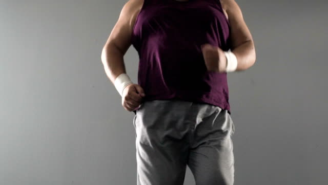 Man losing calories jogging on spot, tired of active weightloss workout, sport video