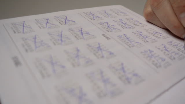 A man makes a date stamp in the calendar diary. Workflow planning. Close up. Marketing the date on the calendar, closeup.