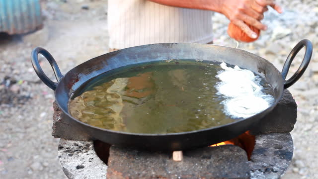 Man making Jalebi at the Street Market Stall video