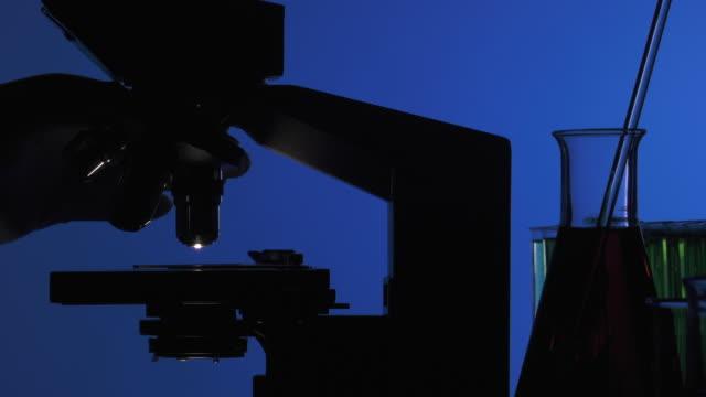 Man manipulating a microscope video