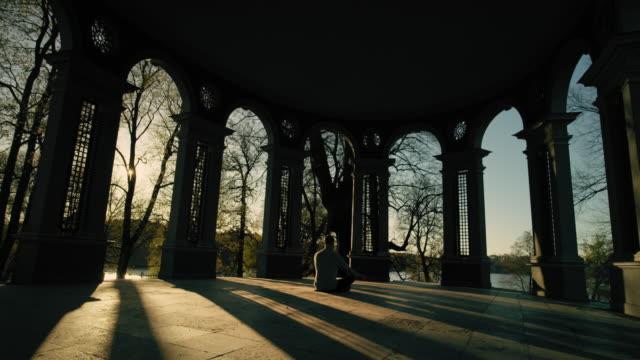 Man meditating at sunrise video