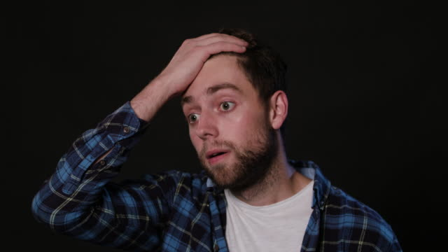 A Man Mimicing Against a Black Background