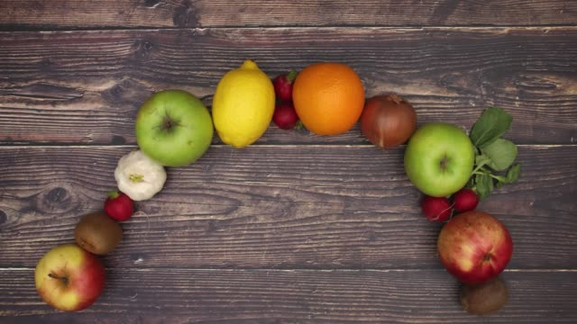 Man move hand and fruits appear - Stop motion