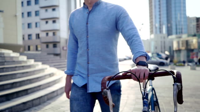 man on a bicycle with a smart clock video