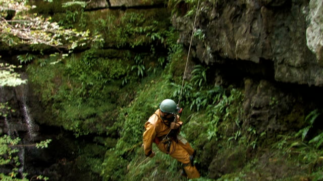 Man on a rope descends into cave video