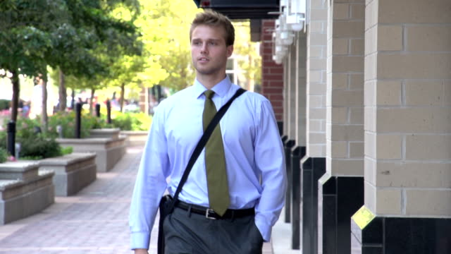 Man on his way to work, entering building video