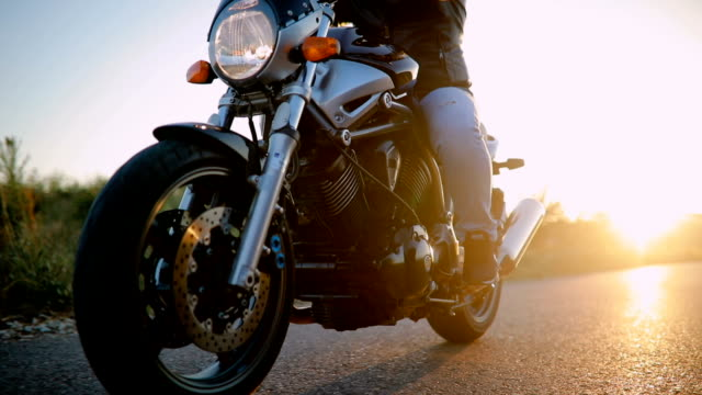 Man on motorcycle in sunset Man driving motorcycle on road, motorcycle shell is custom built motorcycle stock videos & royalty-free footage