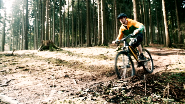 Man on mountain bike rides on track in forest video