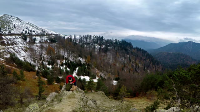 Man On Peak Of Mountain - Searching Backpack - 4K Resolution video