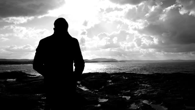 Man on Rock in Autumn Man on Rock in Autumn depression land feature stock videos & royalty-free footage