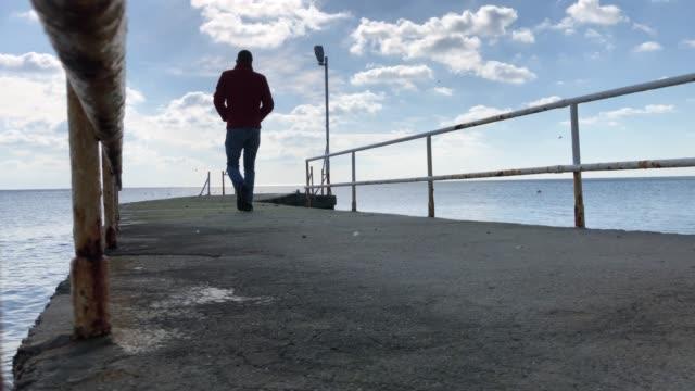 Man on the edge of pier