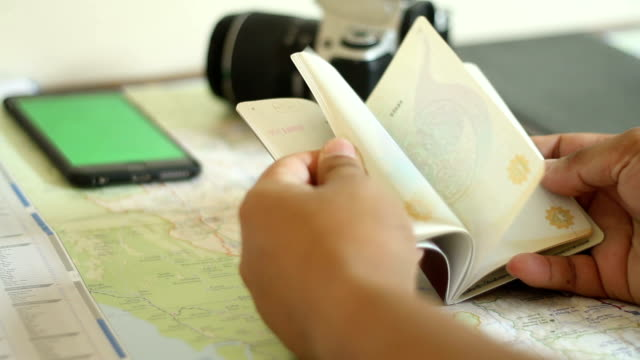 Man open and check your passport and book for travel video