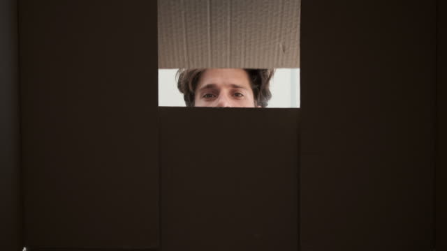 Man opening big cardboard box video