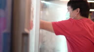 istock Man Opening Refrigerator in Supermarket with bare hand. 1215271659