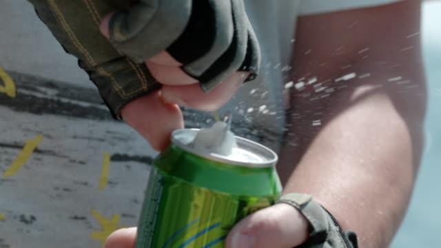 CU Man opening splashing soda can Man opening splashing soda can. CU,slow motion. thirsty stock videos & royalty-free footage