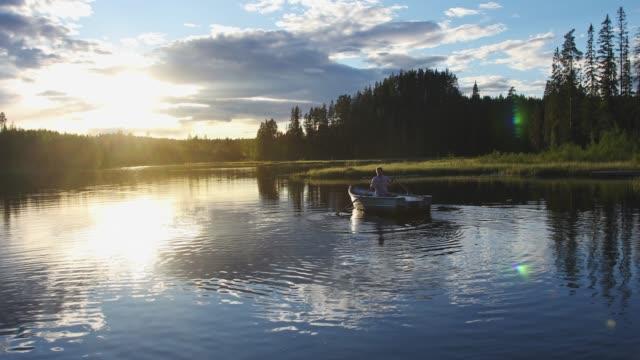 man ut rodd på en sommarkväll - summer sweden bildbanksvideor och videomaterial från bakom kulisserna
