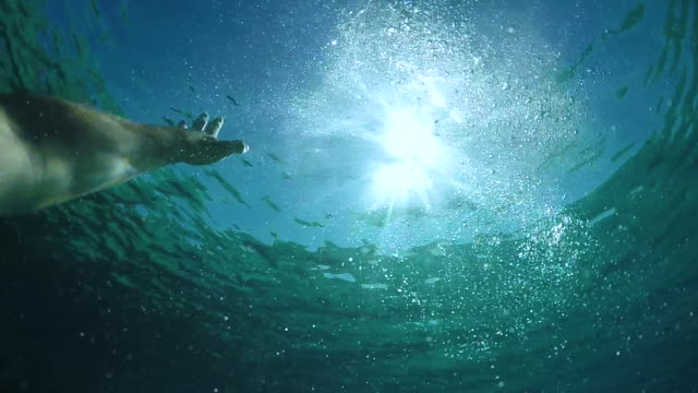 pov: man outstretching his arm and trying to get to the surface while drowning. - avvicinarsi video stock e b–roll