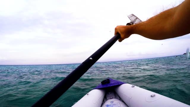 Man paddling a kayak on Mediterranean sea video