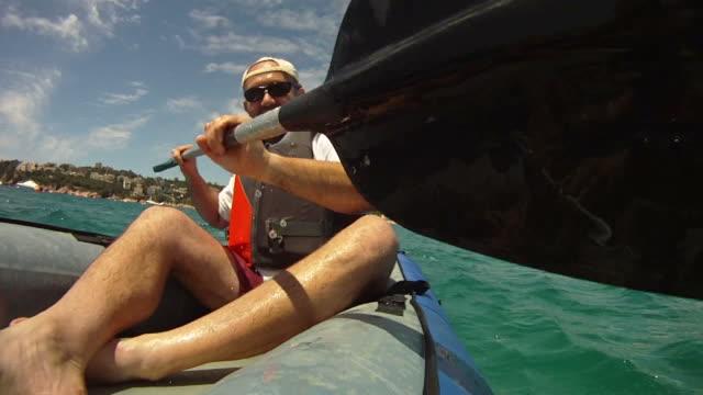 Man paddling in Kayak video