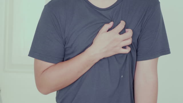 Man painful on his heart at home video
