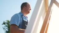 istock Man painting at the Lake shore 1272622457