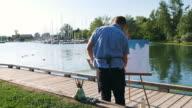 istock Man painting at the Lake shore 1272631910