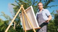 istock Man painting at the Lake shore 1272644285