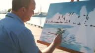 istock Man painting at the Lake shore 1272648726