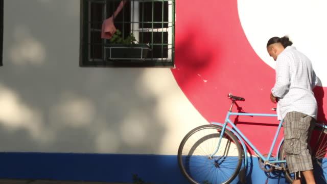 Man parking bicycle