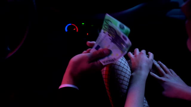 Man paying euros to prostitute, illegal escort services, sexual exploitation