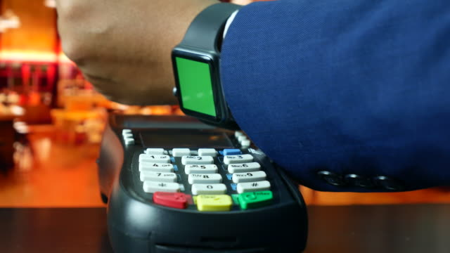 man paying with nfc technology on smart watch green screen in restaurant, contactless payment - contactless payment stock videos & royalty-free footage