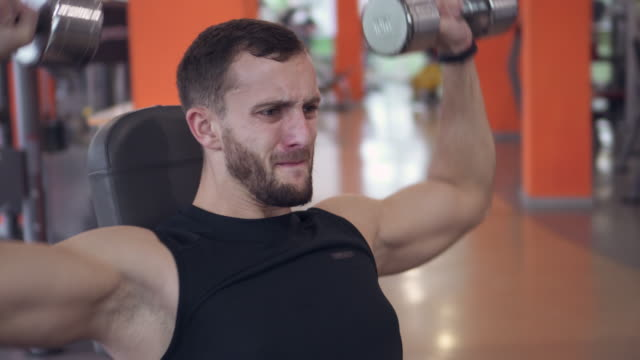 Man performing fitness training workout for biceps video