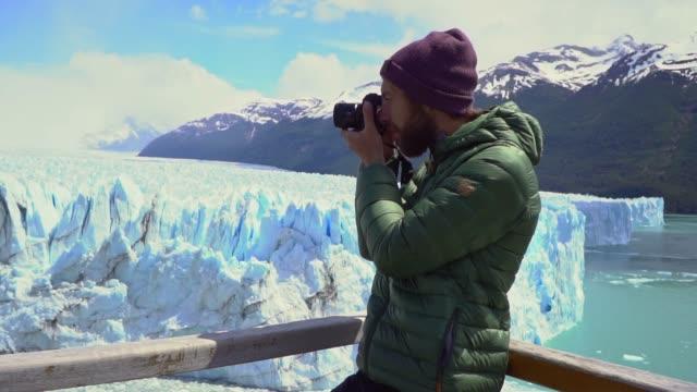 Man photographing  scenic view of Perito Moreno Glacier in Patagonia