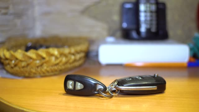man picks up car keys from the table. close-up. man picks up car keys from the table. close-up. car key stock videos & royalty-free footage