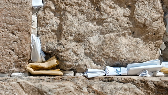 Man Place A Note In The Western Wall In Jerusalem Israel video