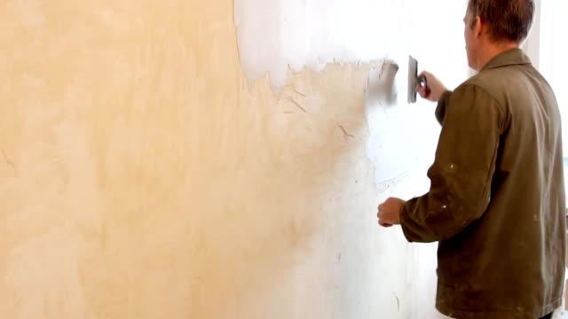 Man plastering wall video